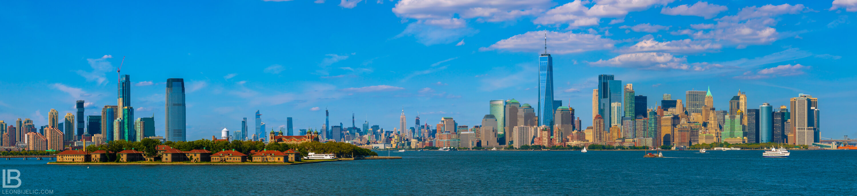 Beautiful panoramic view from a boat to Ellis Island, Jersey City and New York - Photo by Leon Bijelic - Architecture Building Buildings Photos Amazing Great Color